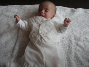 Augustine wearing his Uncle Matthew's baptismal outfit.